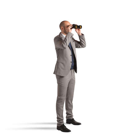 Businessman watching with binoculars on white background