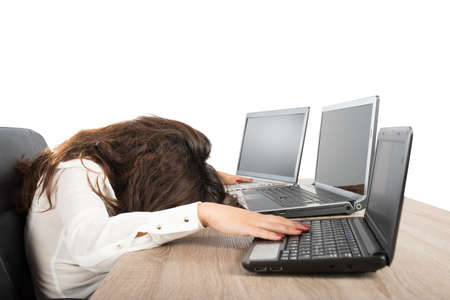 heavy risk: Stressed businesswoman due to overwork against laptop