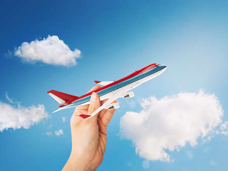 Toy airliner in flight on a sunny day  . 3D Rendering Stock Photo