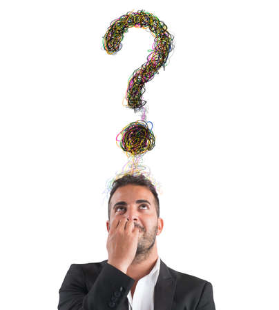 Businessman with big question mark over head Stock Photo