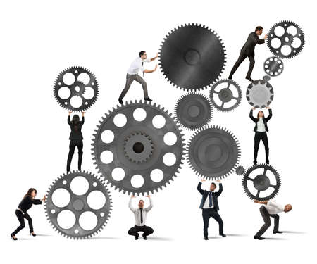 work together: Teamwork of businesspeople work together to a system of gears Stock Photo