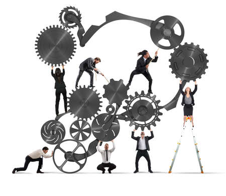 Teamwork of businesspeople work together to a system of gears Archivio Fotografico