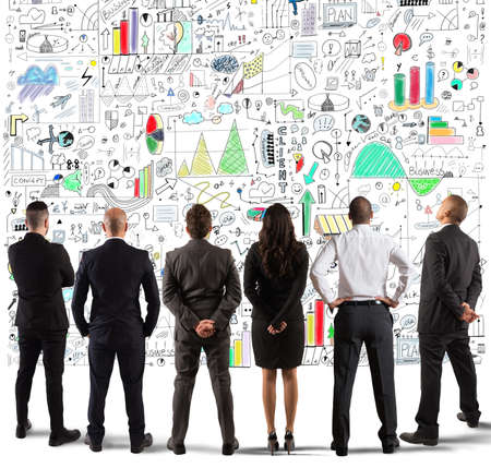 Business team drawing a new complex project on wall Stock Photo