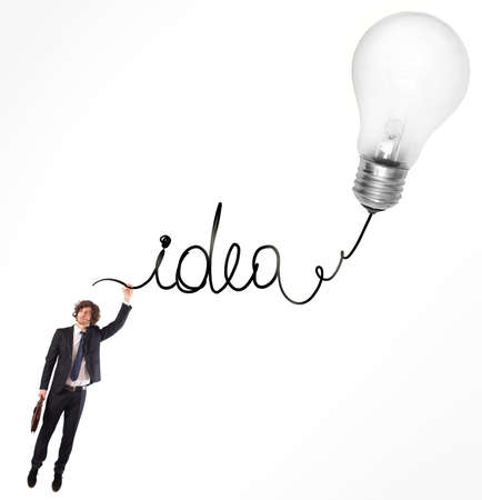 Man hanging on the written idea with light bulb