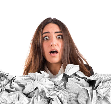 disarray: Shocked businesswoman submerged by the working documents