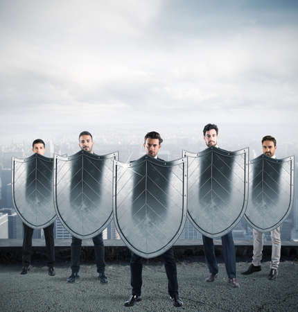 Businessmen with shields. concept of protection and defense in the business world Stock Photo