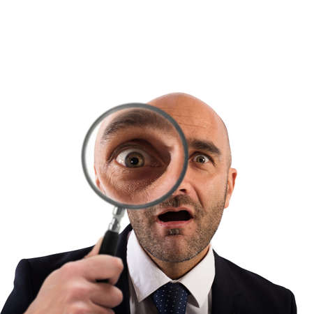 find: Businessman with a magnifying glass on white background