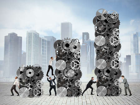 builds: Team builds up statistics with gear systems Stock Photo