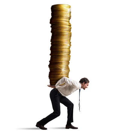 Businessman carries on his back a stack of coins