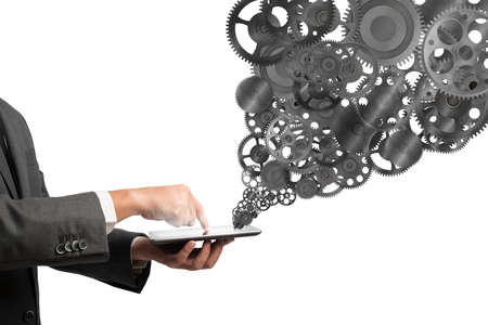 embed: Businessman touch a tablet screen with gears mechanism