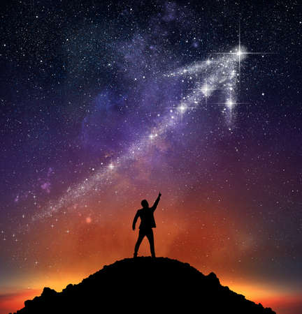 Businessman on a mountain indicate an arrow with stars