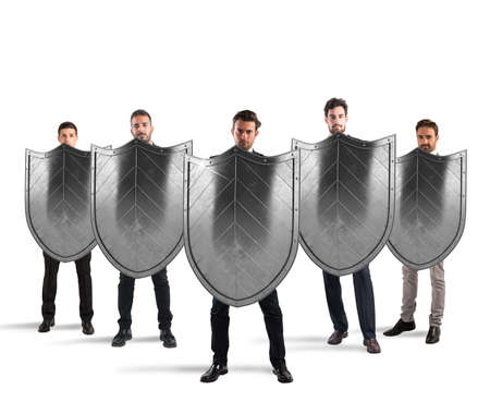 secure: Businessmen with shields. concept of protection and defense in the business world Stock Photo