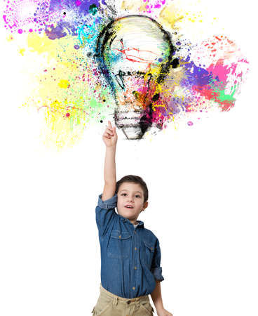 Child indicates a big colored bulb designed photo