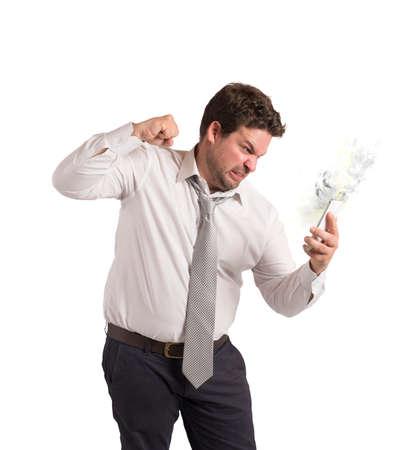 destructive: Businessman stressed from work breaks his cellphone