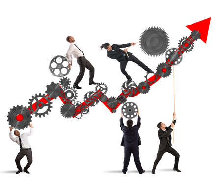 Travail d'équipe construire une flèche vers le haut avec des engrenages mécanisme Banque d'images
