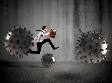 hinder: Businessman between fierce spiky balls that hinder