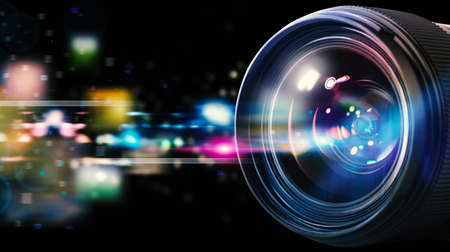 optical equipment: Professional lens of reflex camera with light effects Stock Photo