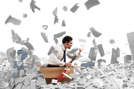 bureaucracy: Concept of bureaucracy with man paddling in a sea of sheets Stock Photo