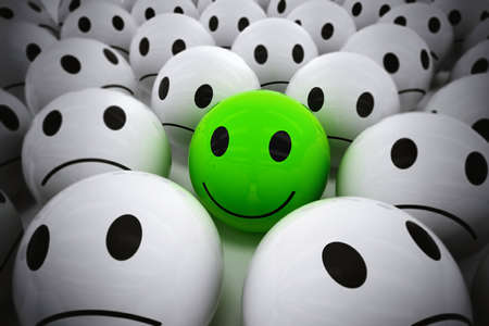 3D Rendering green ball with smiley face among so many white sad balls. happy leader supports his negative team Stock Photo