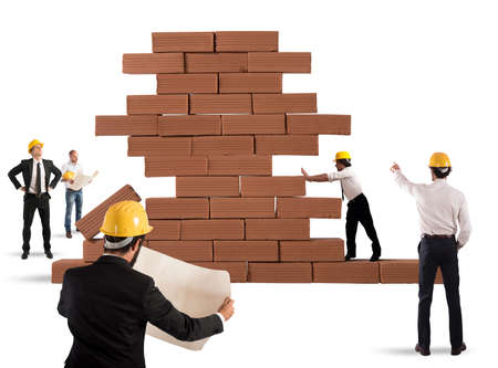 project: Team of architects working and analyzing on a bricks construction project