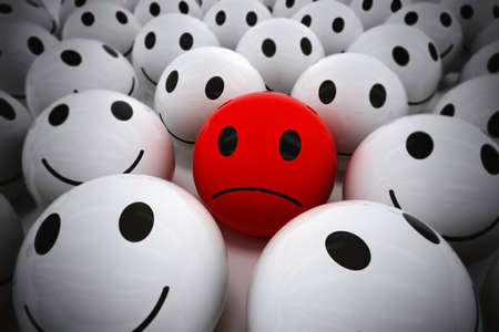 3D Rendering red ball with sad face among so many white smiling balls. happy team support their sad leader Stock Photo
