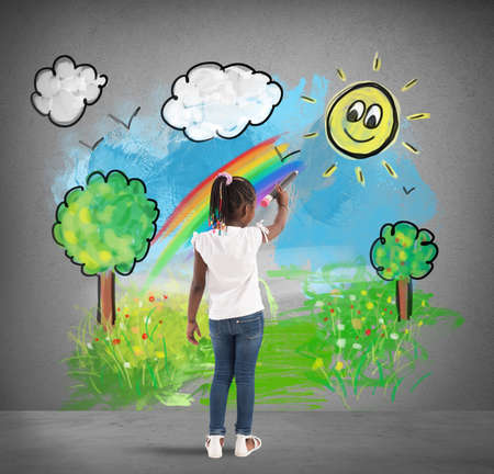 decorate: Creative little girl colors with a big pencil a green landscape