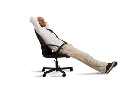 Businessman relax and thinks sitting in a office chair