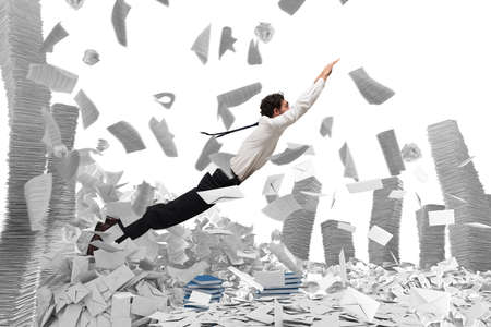 pile of paper: Businessman goes out from a pile of paper sheets