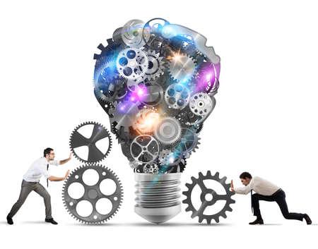 illuminated: Business team push gears towards a great light bulb. build an idea concept