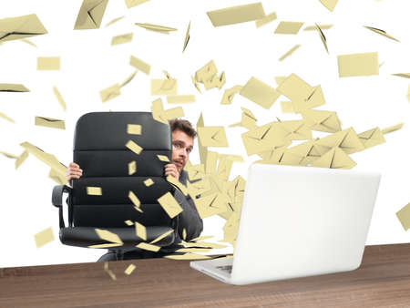 missive: Scared businessman hidden behind the chair submerged by the mail Stock Photo