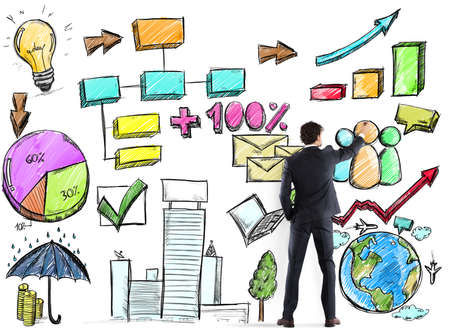 project: Businessman draws plan and project of business analysis Stock Photo