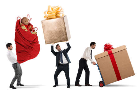 Businessmen pushes and holds heavy big gifts Stock Photo