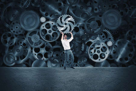 machinery: Businessman builds a business system as a gears mechanism and puts the missing gear Stock Photo