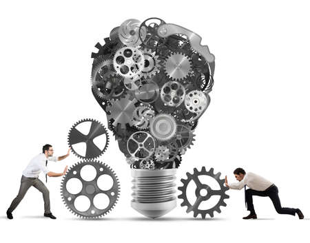 power of thinking: Business team push gears towards a great light bulb. build an idea concept
