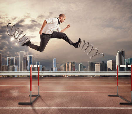 Businessman running fast with the big springs during a race with obstacles. 3D Rendering