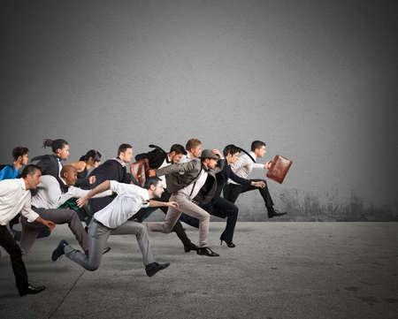competitive: Business people run together in the same direction Stock Photo