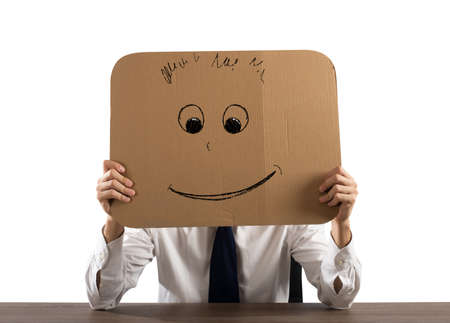 Businessman in the office holds a cardboard with a smiley face Stockfoto - 132294131