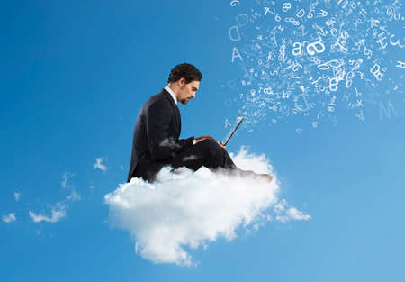 Businessman with laptop on a cloud in the sky. Internet and social network concept Stockfoto - 132294132