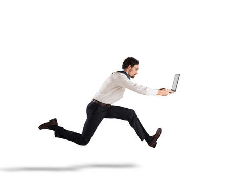Fast business concept with businessman running with a laptop