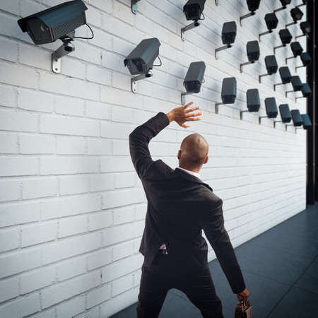 electronic: Afraid man with cameras pointed at him. 3D Rendering Stock Photo