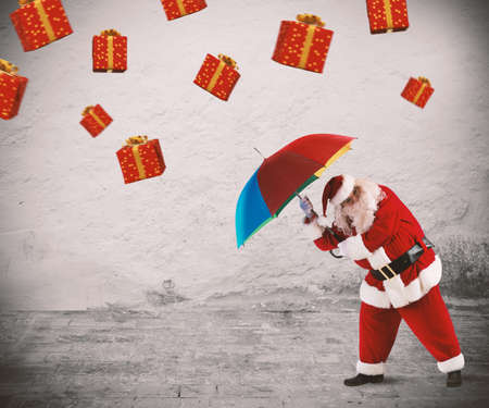 box: Santa claus is protected by gifts with umbrella