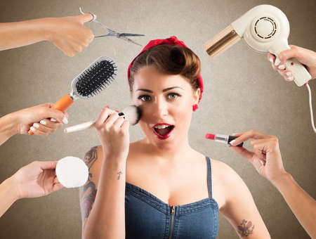 Pin-up girl made up and coiffed by many hands Stockfoto - 132294136