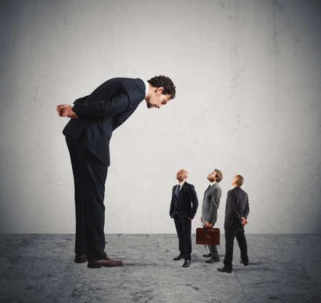 powerless: Big businessman looking small businessmen. Severe boss humiliates his employees