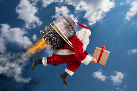 Santa Claus with gift box flies with a missile in the sky