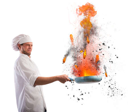 Bumbling chef holds a pan on fire Stockfoto