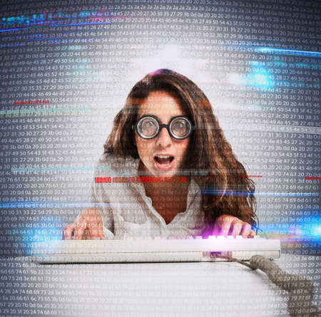 tiredness: Woman with astonished expression and eyeglasses with computer keyboard