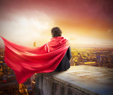 strong: Man with cloak view from above the city Stock Photo