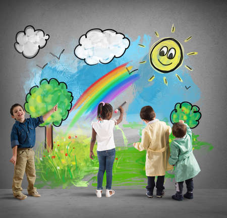 Children color a sunny landscape on a gray wall with cloud photo