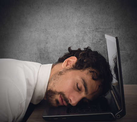 resting: Businessman exhausted from overwork sleeping over computer Stock Photo