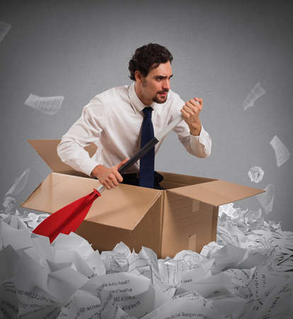 float: Concept of bureaucracy with man paddling in a sea of sheets Stock Photo